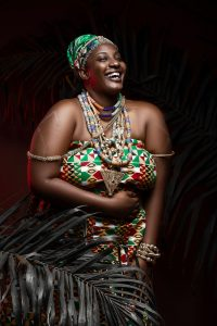 smiling black woman in traditional outfit and accessories